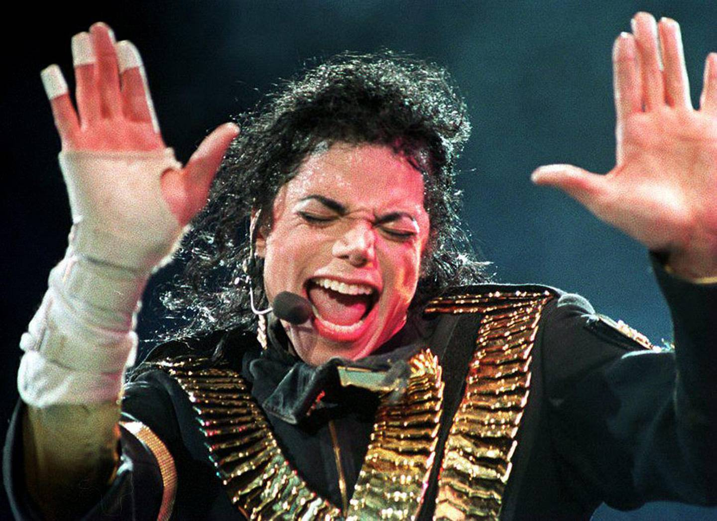"""(FILES) In this file photo taken on August 31, 1993, US pop megastar Michael Jackson performs during his """"Dangerous"""" tour in Singapore.   An unflinching new documentary on pedophilia accusations against Michael Jackson shatters the veneer of his larger-than-life celebrity, presenting in stark, lurid detail the stories of two men who say the late King of Pop for years sexually abused them as minors. / AFP / STR"""
