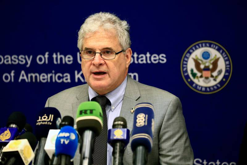 Top US envoy in Khartoum, Charge D'affaires Steven Koutsis, speaks during a press conference at the US embassy on October 7, 2017, a day after Washington lifted its 20-year-old trade embargo imposed on Sudan over alleged support to violent Islamist groups. - The US decision came after months of diplomatic talks between the two countries that began during the tenure of former US president Barack Obama. (Photo by ASHRAF SHAZLY / AFP)