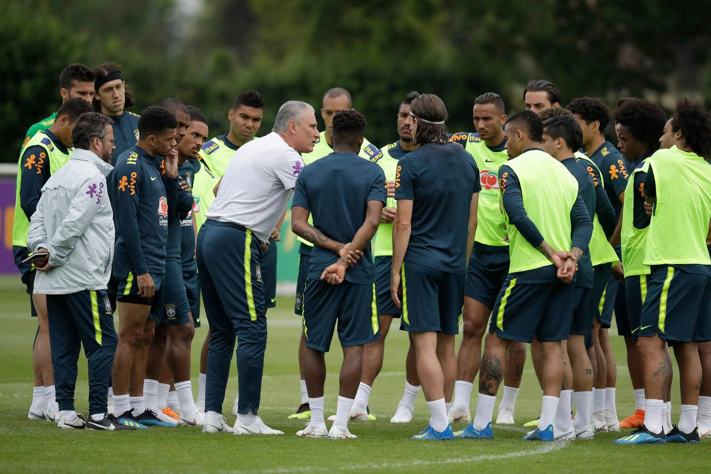 Brazil's head coach Tite, center left, talks to his players during a national soccer squad training session at the training facilities of Tottenham Hotspur football club in Enfield, England, Thursday, June 7, 2018. (AP Photo/Matt Dunham)
