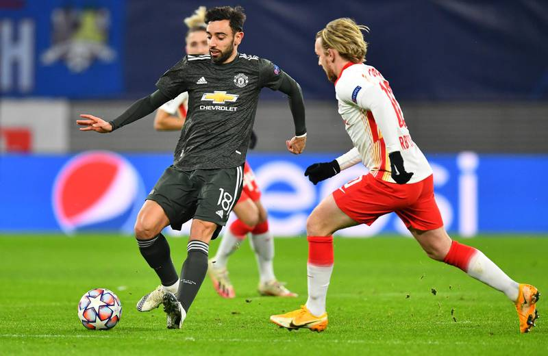 LEIPZIG, GERMANY - DECEMBER 08: Bruno Fernandes of Manchester United is challenged by Emil Forsberg of RB Leipzig during the UEFA Champions League Group H stage match between RB Leipzig and Manchester United at Red Bull Arena on December 08, 2020 in Leipzig, Germany. Sporting stadiums around Germany remain under strict restrictions due to the Coronavirus Pandemic as Government social distancing laws prohibit fans inside venues resulting in games being played behind closed doors. (Photo by Stuart Franklin/Getty Images)