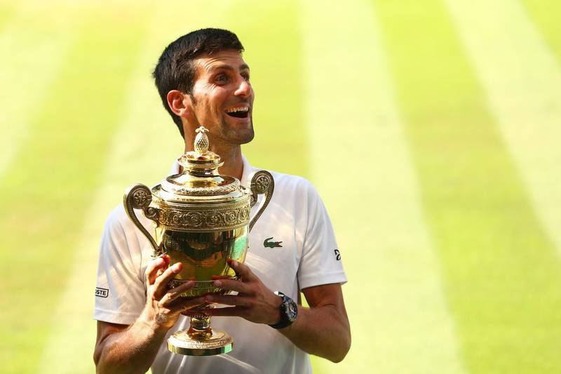 LONDON, ENGLAND - JULY 15:  Novak Djokovic of Serbia celebrates with the trophy after winning the Men's Singles final against Kevin Anderson of South Africa on day thirteen of the Wimbledon Lawn Tennis Championships at All England Lawn Tennis and Croquet Club on July 15, 2018 in London, England.  (Photo by Matthew Stockman/Getty Images) *** BESTPIX ***