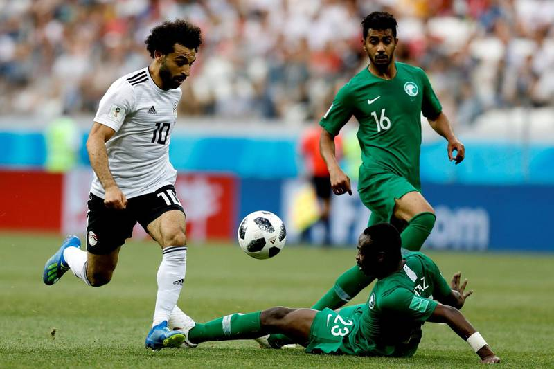 VOLGOGRAD, RUSSIA - JUNE 25 : Mohamed Salah (L) of Egypt in action against Motaz Hawsawi (R) of Saudi Arabia during the 2018 FIFA World Cup Russia Group A match between Saudi Arabia and Egypt at the Volgograd Arenain Volgograd, Russia on June 25, 2018. (Photo by Gokhan Balci/Anadolu Agency/Getty Images)