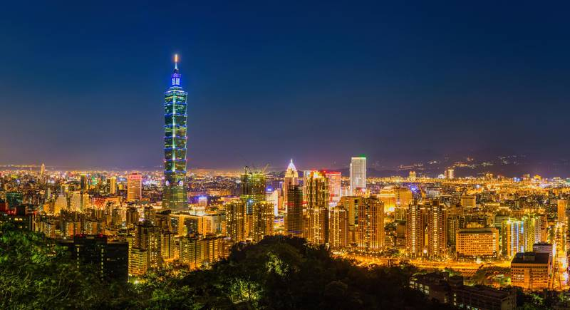 Aerial panorama of Taipei City at dusk, with a view of Taipei 101. Getty Images