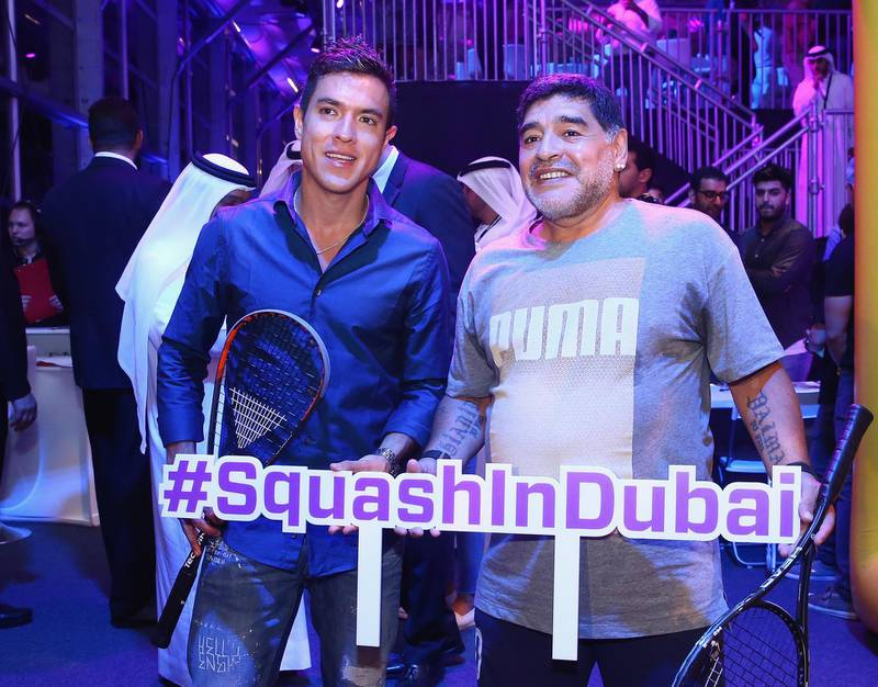 DUBAI, UNITED ARAB EMIRATES - MAY 28:  Diego Maradona poses for a photograph with Miguel Angel Rodriguez of Colombia during the men's final match of the PSA Dubai World Series Finals 2016 at Burj Park on May 28, 2016 in Dubai, United Arab Emirates.  (Photo by Francois Nel/Getty Images)