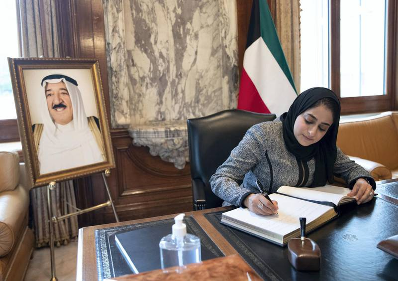 LONDON 1st October 2020. Rua AlZadjali from the Oman Embassy in London signs a book of condolence at the Kuwait Embassy in London following the death of the Emir of Kuwait. Stephen Lock for the National