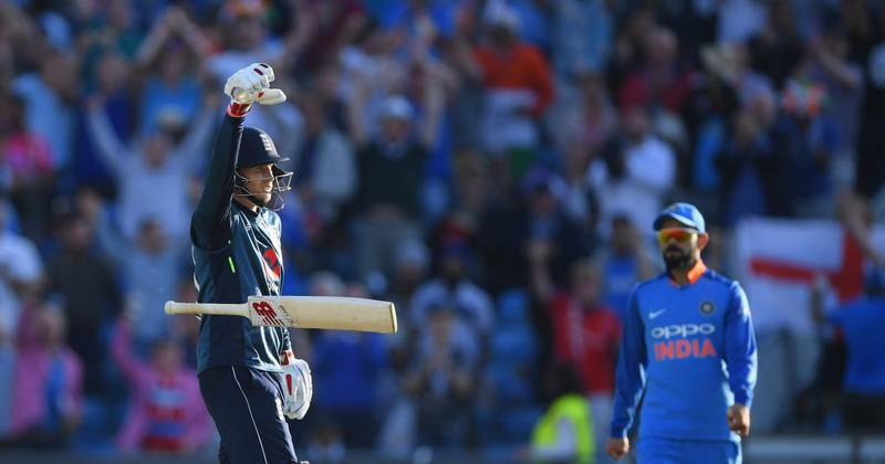LEEDS, ENGLAND - JULY 17:  England batsman Joe Root celebrates his century off the last ball of the match as Virat Kohli looks on during 3rd ODI Royal London One Day match between England and India at Headingley on July 17, 2018 in Leeds, England.  (Photo by Stu Forster/Getty Images)