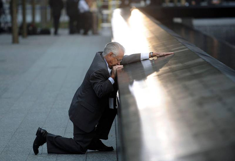 Robert Peraza, who lost his son Robert David Peraza, pauses at his son's name at the North Pool of the 9/11 Memorial during tenth anniversary ceremonies at the site of the World Trade Center in New York, September 11, 2011. The 9/11 attacks changed life in the United States forever, but 10 years after the devastating hit, New Yorkers have learned to live in a more dangerous world and are ready to move on.      REUTERSJustin Lane/Pool   (UNITED STATES - Tags: ANNIVERSARY DISASTER TPX IMAGES OF THE DAY) *** Local Caption ***  NYC402_SEPT11_0911_11.JPG