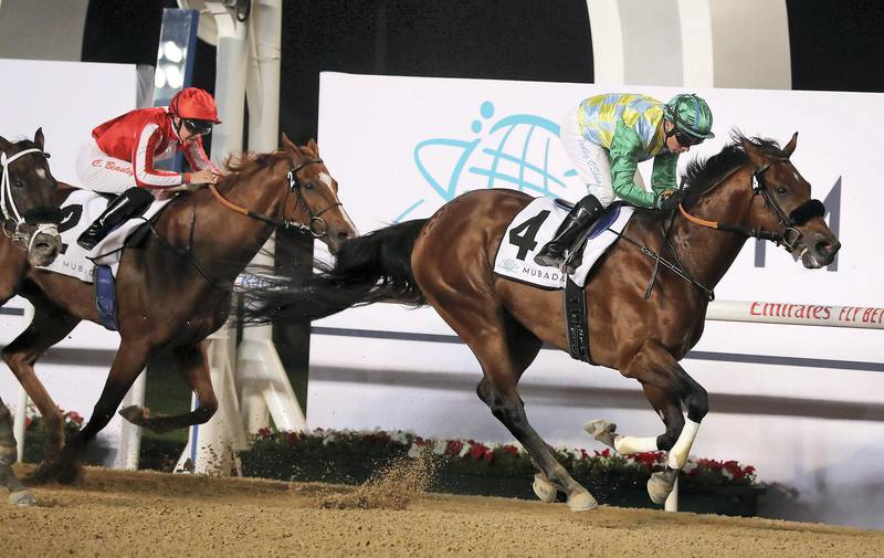 DUBAI , UNITED ARAB EMIRATES , Dec 19  – 2019 :- Tadhg O'Shea (no 4) guides Secret Ambition (GB)  to win the 5th horse race, Dubai Creek Mile, 1600m dirt at the Meydan Racecourse in Dubai. ( Pawan Singh / The National ) For Sports. Story by Amith
