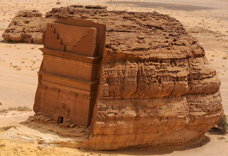 A picture taken on April 1, 2018 shows an aerial view of the Qasr al-Farid tomb (The Lonely Castle) carved into rose-coloured sandstone in Madain Saleh, a UNESCO World Heritage site, near Saudi Arabia's northwestern town of al-Ula. - Al-Ula, an area rich in archaeological remnants, is seen as a jewel in the crown of future Saudi attractions as the austere kingdom prepares to issue tourist visas for the first time -- opening up one of the last frontiers of global tourism. Saudi Crown Prince Mohammed bin Salman is set to sign a landmark agreement with Paris on April 10, 2018 for the touristic and cultural development of the northwestern site, once a crossroads of ancient civilisations. (Photo by FAYEZ NURELDINE / AFP)