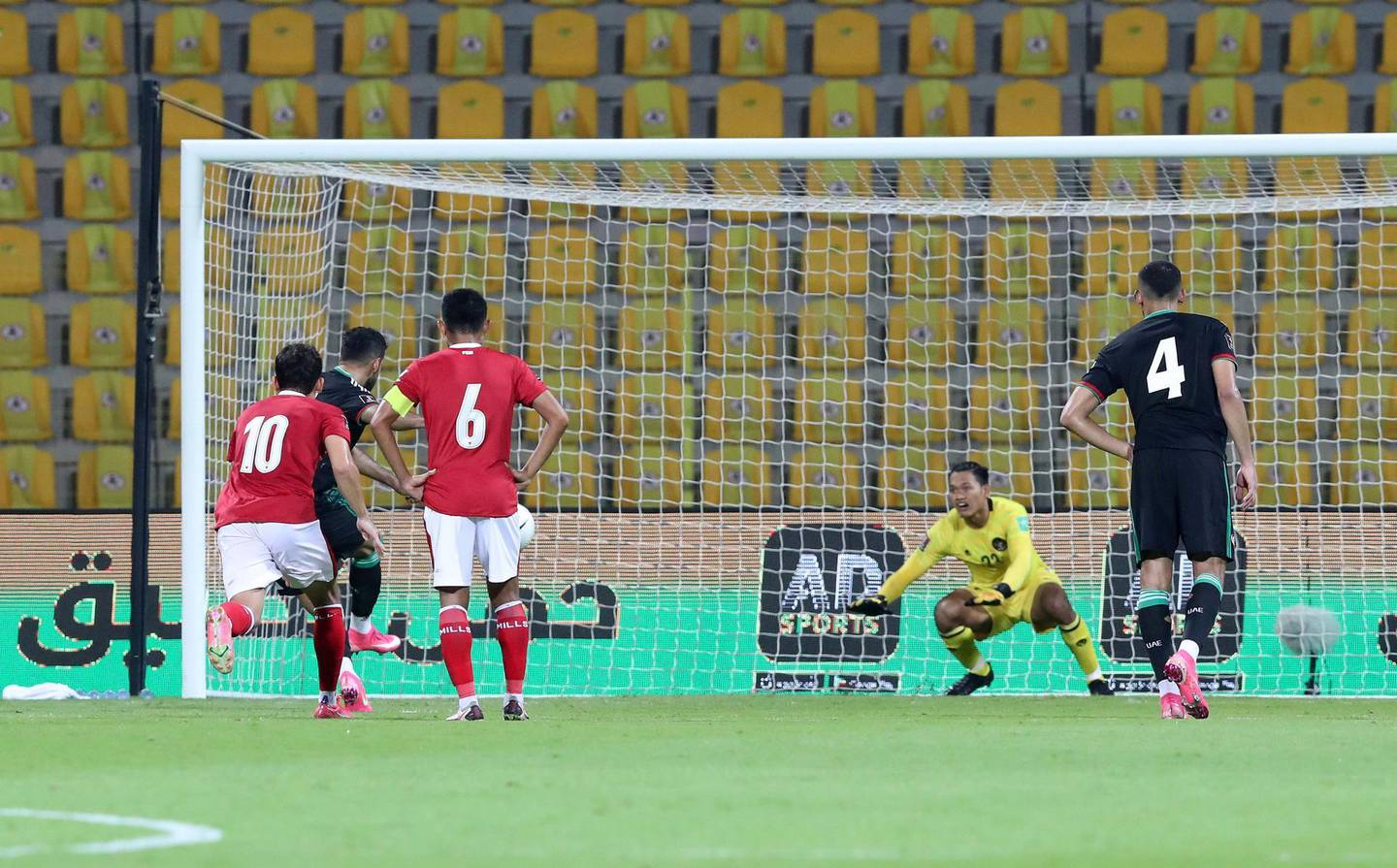 UAE's Ali Mabkhout scores his second goal from the spot during the game between the UAE and Indonesia in the World cup qualifiers at the Zabeel Stadium, Dubai on June 11th, 2021. Chris Whiteoak / The National.  Reporter: John McAuley for Sport
