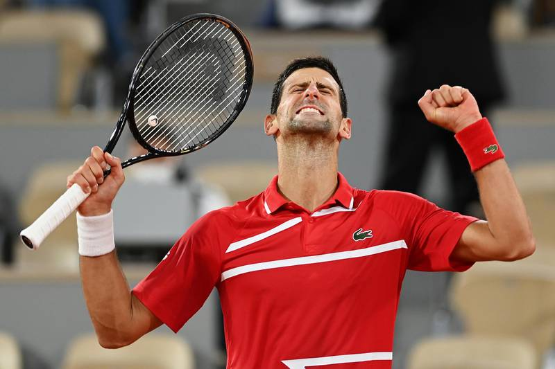 PARIS, FRANCE - OCTOBER 05: Novak Djokovic of Serbia celebrates after winning match point during his Men's Singles fourth round match against Karen Khachanov of Russia on day nine of the 2020 French Open at Roland Garros on October 05, 2020 in Paris, France. (Photo by Shaun Botterill/Getty Images)