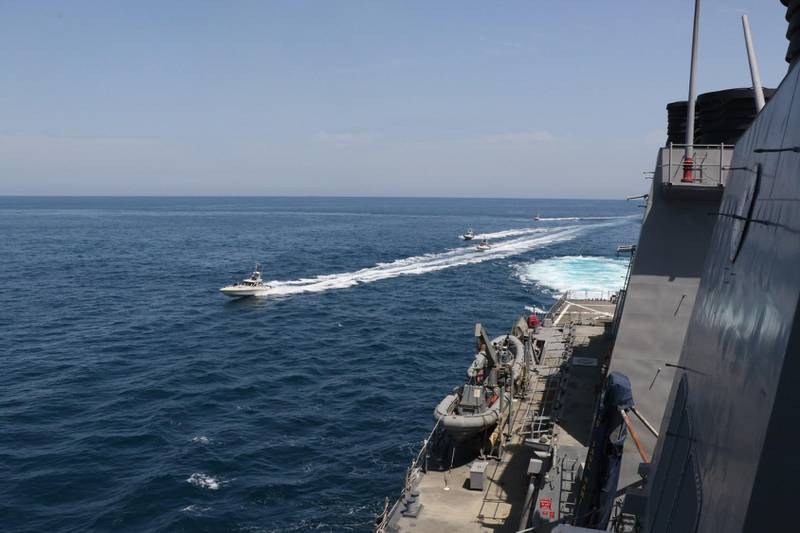 """This US Navy photo obtained April 22, 2020 shows Iranian Islamic Revolutionary Guard Corps Navy (IRGCN) vessels conducting unsafe and unprofessional actions against the guided-missile destroyer USS Paul Hamilton (DDG 60) and other US military ships by crossing the ships' bows and sterns at close range while operating in international waters of the north Gulf on April 15, 2020.  Paul Hamilton is conducting joint interoperability operations in support of maritime security in the US 5th Fleet area of operations. US President Donald Trump said April 22, 2020 he had ordered the US military to attack and destroy any Iranian vessel that harasses US Navy ships. """"I have instructed the United States Navy to shoot down and destroy any and all Iranian gunboats if they harass our ships at sea,"""" Trump said on Twitter.  - RESTRICTED TO EDITORIAL USE - MANDATORY CREDIT """"AFP PHOTO /US NAVY/HANDOUT """" - NO MARKETING - NO ADVERTISING CAMPAIGNS - DISTRIBUTED AS A SERVICE TO CLIENTS  / AFP / Navy Office of Information / Handout / RESTRICTED TO EDITORIAL USE - MANDATORY CREDIT """"AFP PHOTO /US NAVY/HANDOUT """" - NO MARKETING - NO ADVERTISING CAMPAIGNS - DISTRIBUTED AS A SERVICE TO CLIENTS"""