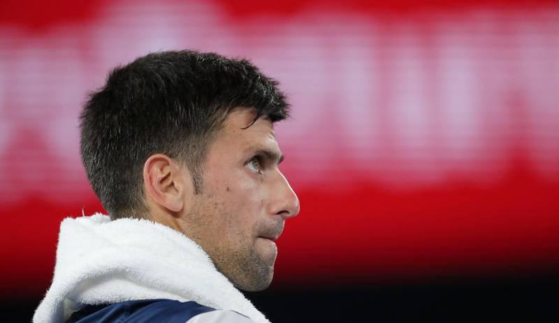 epa06464537 Novak Djokovic of Serbia looks on during a break in his fourth round match against Chung Hyeon of South Korea at the Australian Open Grand Slam tennis tournament in Melbourne, Australia, 22 January 2018.  EPA/MAST IRHAM