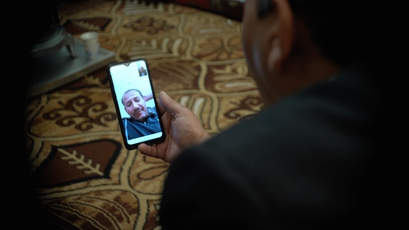 Mohammed Jomaa video calling his brother Abed in the USA. Mahmoud Rida/ The National