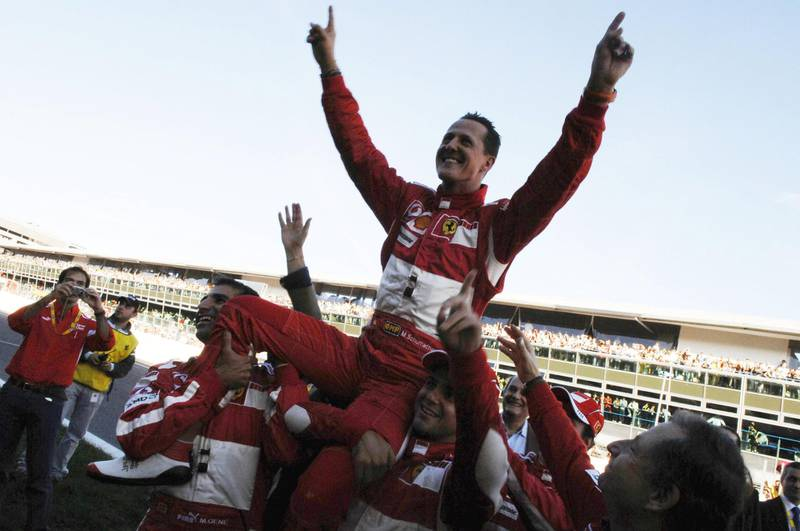 MONZA, ITALY - OCTOBER 29:  German Ferrari driver Michael Schumacher waves to fans during the Ferrari Days on October 29, 2006 in Monza, Italy. Schumacher retired from Formula 1 at the end of the 2006 season after amassing a career 91 Grand Prix wins and 7 World Titles. (Photo by Flavio Mazzi/Bongarts/Getty Images)