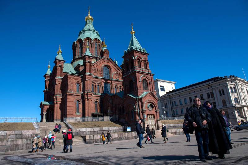 Tourists take photographs in front of Russian Orthodox Uspenski Cathedral on March 30, 2018 in Helsinki, Finland. (Photo by Chris J Ratcliffe/Getty Images)