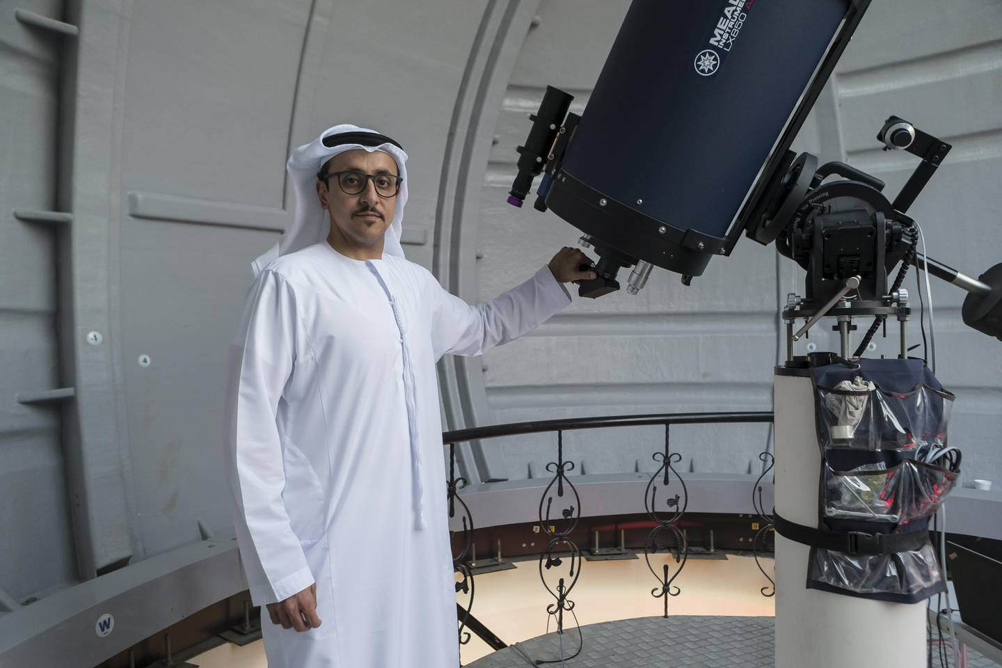 ABU DHABI, UNITED ARAB EMIRATES, 07 JANUARY 2017. An Emiratis childhood fascination with the desert night sky led to Thabet Al Qaisseh building an observatory on his family's farm in Al Wathba. Thabet regularly invites the public and students to his observatory, called the Al Sadeem Observatory, to further their understanding of astronomy and to promote the space sector amongst the youth. Thabet sets the telescope of the observatory to look at the brightly lit moon just before sunset. (Photo: Antonie Robertson/The National) ID: 12286. Journalist: Thamer Subaihi. Section: National. *** Local Caption ***  AR_0701_Al_Sadeem_Observatory-15.JPG