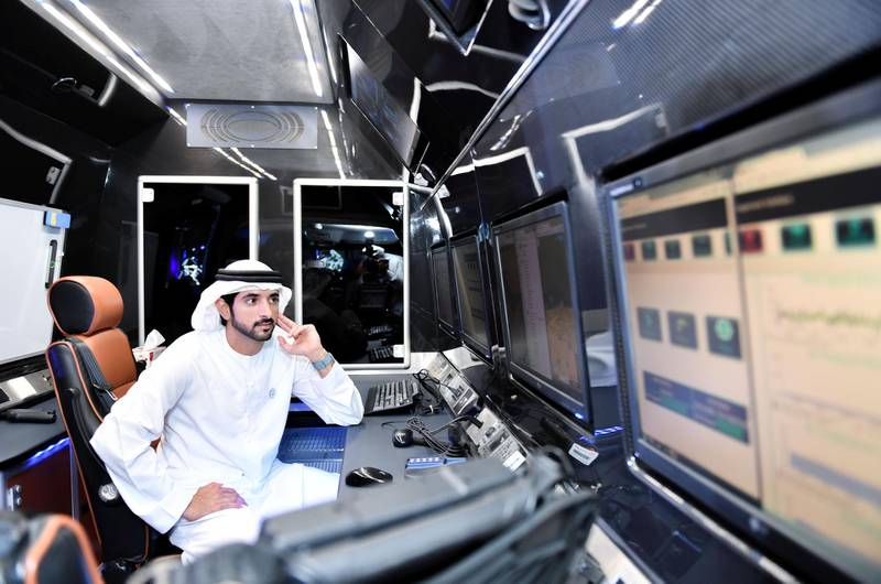 Dubai Crown Prince Hamdan bin Mohammed inspects RTA Dubai's autonomous mobility and AI projects during a visit to Metro Depot at Al Rashidiya. Dubai Media Office / Wam