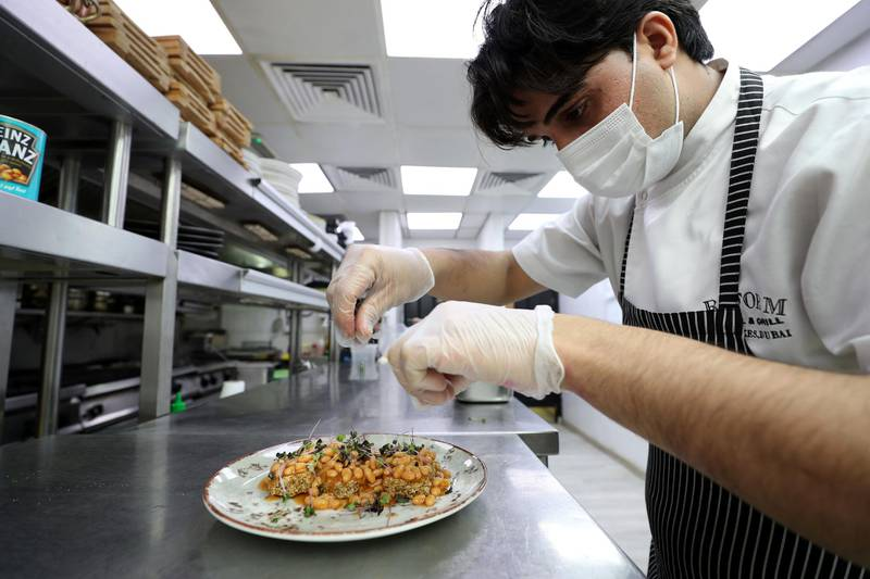 Dubai, United Arab Emirates - Reporter: N/A. Lifestyle. Sous Chef Usama Shah prepares the baked beans of Weetabix. Reform Social & Grill have started seeing baked beans and wheetabix plus there own concoctions. Tuesday, February 16th, 2021. Dubai. Chris Whiteoak / The National