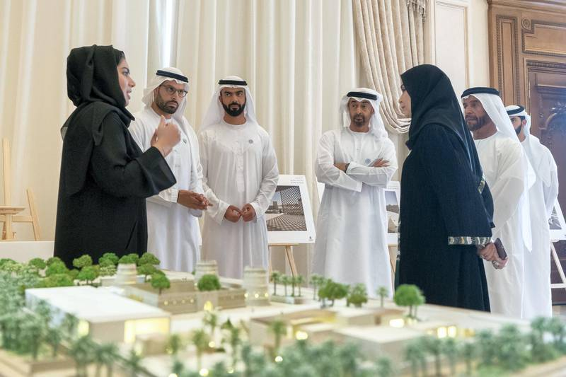 ABU DHABI, UNITED ARAB EMIRATES - October 29, 2018: HH Sheikh Mohamed bin Zayed Al Nahyan Crown Prince of Abu Dhabi Deputy Supreme Commander of the UAE Armed Forces (4th L), views designs of the new Al Ain Museum, during a Sea Palace barza.��Seen with HE Mohamed Khalifa Al Mubarak, Chairman of the Department of Culture and Tourism and Abu Dhabi Executive Council Member (2nd L), HE Saif Ghobash, Director General of Abu Dhabi Tourism and Culture Authority (3rd L)., HE Dr Amal Abdullah Al Qubaisi, Speaker of the Federal National Council (FNC) (R) and HH Sheikh Saif bin Mohamed Al Nahyan (2nd R).   (�� / Crown Prince Court - Abu Dhabi ) ---