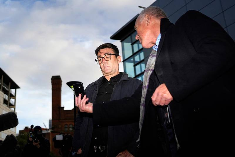 MANCHESTER, UNITED KINGDOM – OCTOBER 20: Greater Manchester mayor Andy Burnham (left) with leader of Manchester City Council Sir Richard showing him the news from London when the Tier 3 measures will come into force on October 20, 2020 in Manchester, England. Talks between the Housing and Communities Minister, Robert Jenrick, and the Manchester Mayor, Andy Burnham, collapsed today after they failed to agree a financial package to help Mancunians whose jobs are threatened by a Tier Three lockdown.  (Photo by Christopher Furlong/Getty Images)