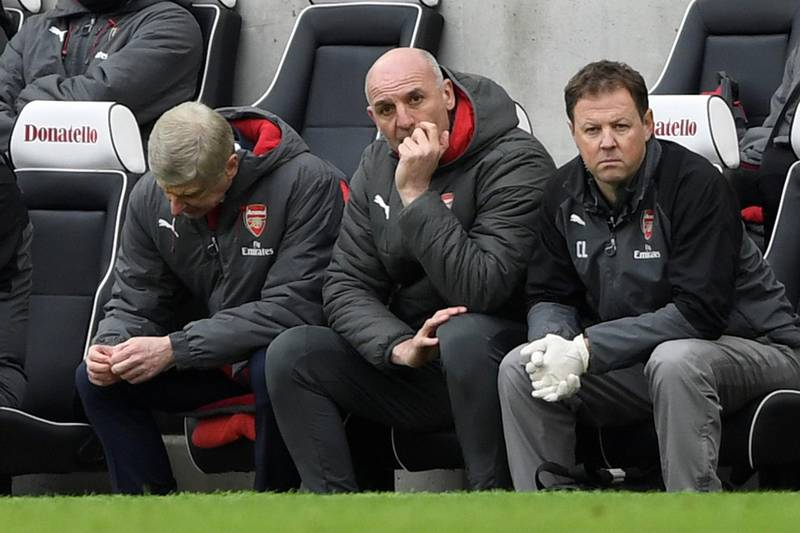 """Soccer Football - Premier League - Brighton & Hove Albion vs Arsenal - The American Express Community Stadium, Brighton, Britain - March 4, 2018   Arsenal manager Arsene Wenger and assistant manager Steve Bould look dejected    Action Images via Reuters/Tony O'Brien    EDITORIAL USE ONLY. No use with unauthorized audio, video, data, fixture lists, club/league logos or """"live"""" services. Online in-match use limited to 75 images, no video emulation. No use in betting, games or single club/league/player publications.  Please contact your account representative for further details."""