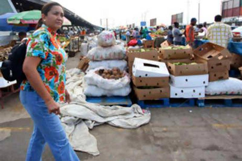 Josephine Jimenez, president of the Victoria 1522 investment fund, walks  through the Market Place in Port of Spain, Trinidad, April 15, 2010. Jimenez, a pioneering specialist in so-called frontier markets, visited Trinidad as part of a 10-country tour to scout out investment opportunities for her fund. Picture taken April 15, 2010.   To match Feature FRONTIERS/SPECIAL-REPORT    REUTERS/Andrea De Silva (TRINIDAD AND TOBAGO - Tags: BUSINESS SOCIETY)