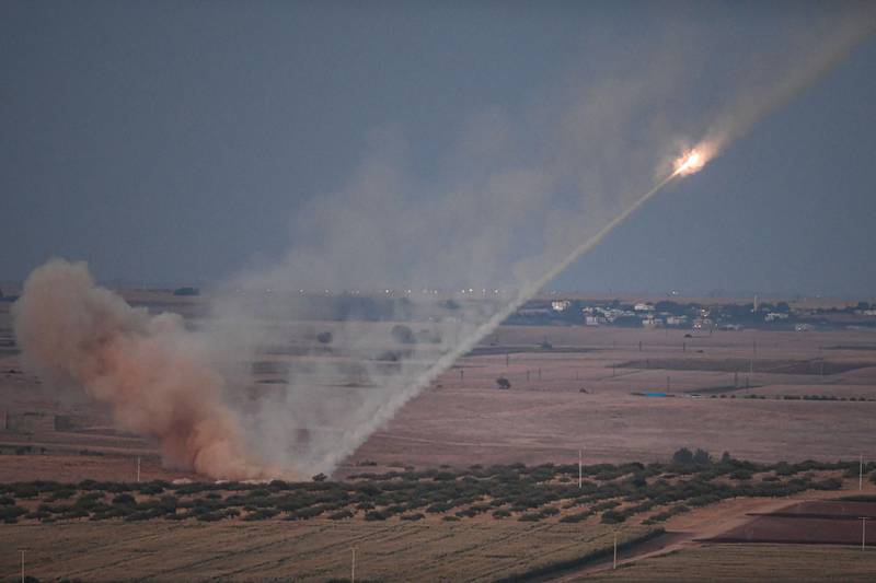 """This picture taken on October 15, 2019 shows a missile fired by Turkish forces towards the Syrian town of Ras al-Ain, from the Turkish side of the border at Ceylanpinar district in Sanliurfa on the first week of Turkey's military operation against Kurdish forces.  The United States is not aware of any """"major"""" escape of Islamic State extremists since Turkey launched its assault on Syrian Kurdish fighters holding the prisoners, an official said Tuesday. / AFP / Ozan KOSE"""
