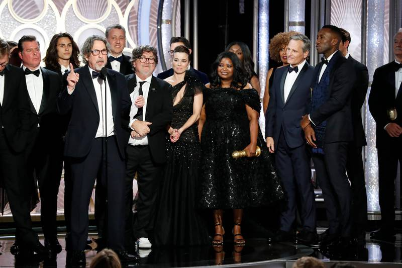 """This image released by NBC shows Peter Farrelly, foreground, accepting the award for best comedy film for """"Green Book"""" during the 76th Annual Golden Globe Awards at the Beverly Hilton Hotel on Sunday, Jan. 6, 2019, in Beverly Hills, Calif. (Paul Drinkwater/NBC via AP)"""