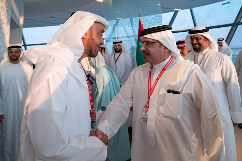 YAS ISLAND, ABU DHABI, UNITED ARAB EMIRATES - December 01, 2019: HH Sheikh Mohamed bin Zayed Al Nahyan, Crown Prince of Abu Dhabi and Deputy Supreme Commander of the UAE Armed Forces (L), greets HRH Prince Salman Bin Hamad Bin Isa Al Khalifah Crown Prince and First Deputy Supreme Commander of Bahrain (R), at Shams Tower during the Formula 1 2019 Etihad Airways Abu Dhabi Grand Prix at Yas Marina Circuit.   ( Hamad Al Kaabi  / Ministry of Presidential Affairs ) ---
