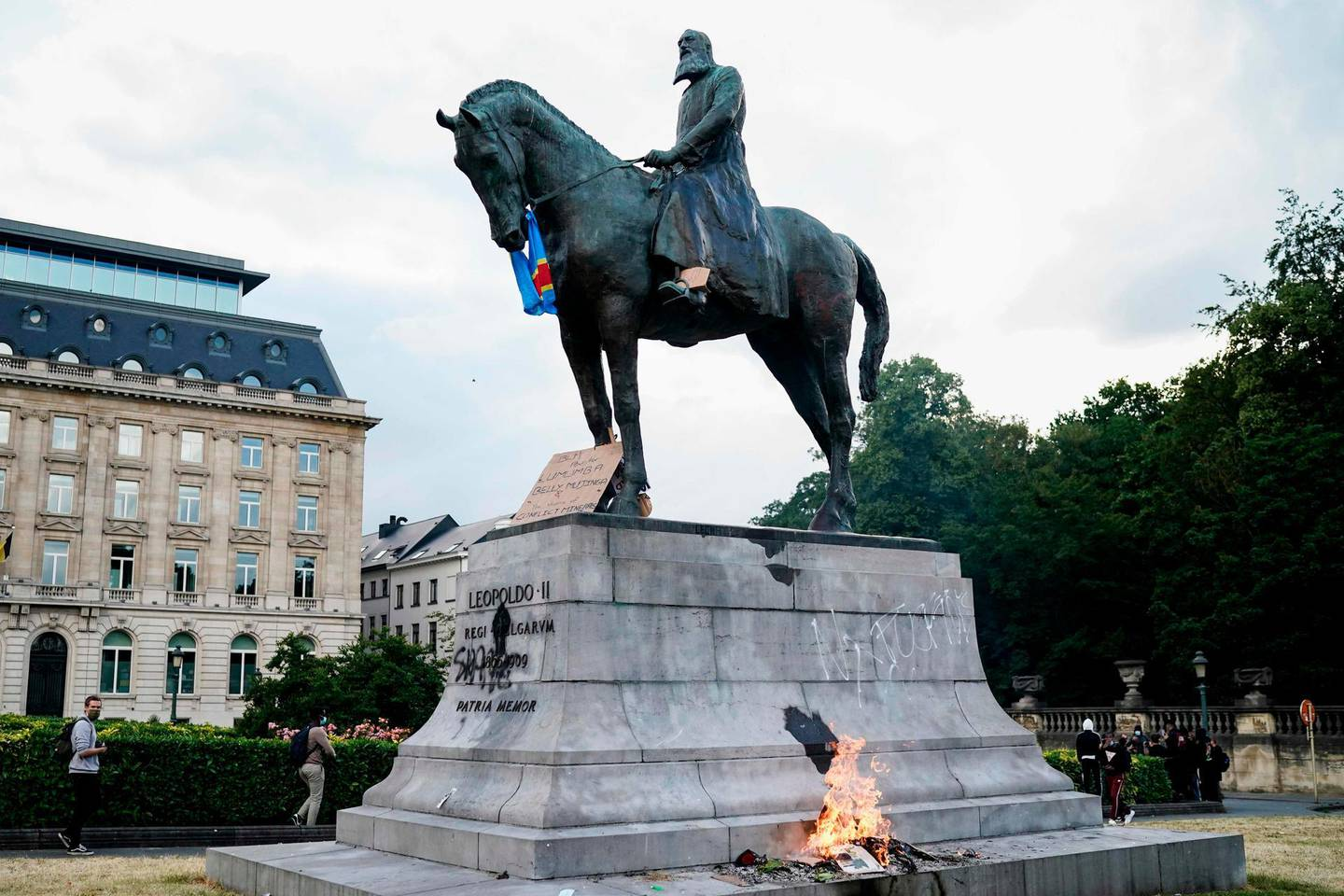 The King Leopold II of Belgium statue is pictured during an anti-racism protest, in Brussels, on June 7, 2020, as part of a weekend of 'Black Lives Matter' worldwide protests against racism and police brutality in the wake of the death of George Floyd, an unarmed black man killed while apprehended by police in Minneapolis, US.   / AFP / Kenzo TRIBOUILLARD
