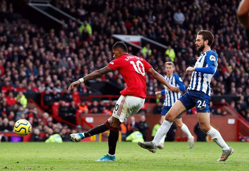 """Manchester United's Marcus Rashford scores his side's third goal of the game during the Premier League match at Old Trafford, Manchester. PA Photo. Picture date: Sunday November 10, 2019. See PA story SOCCER Man Utd. Photo credit should read: Martin Rickett/PA Wire. RESTRICTIONS: EDITORIAL USE ONLY No use with unauthorised audio, video, data, fixture lists, club/league logos or """"live"""" services. Online in-match use limited to 120 images, no video emulation. No use in betting, games or single club/league/player publications."""