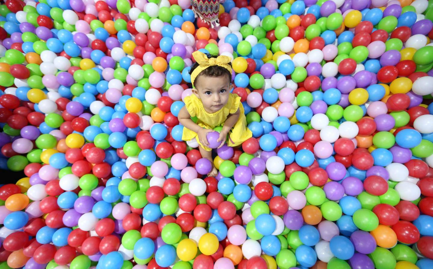 epa06963190 Children enjoy the first day of the Muslim holiday of holy festival of Eid Al Adha at Kids Fun House in Qanat Al Qasba in Gulf emirate of Sharjah, United Arab Emirates, 21 August 2018. Eid al-Adha is the holiest of the two Muslims holidays celebrated each year, it marks the yearly Muslim pilgrimage (Hajj) to visit Mecca, the holiest place in Islam. Muslims slaughter a sacrificial animal and split the meat into three parts, one for the family, one for friends and relatives, and one for the poor and needy.  EPA/ALI HAIDER