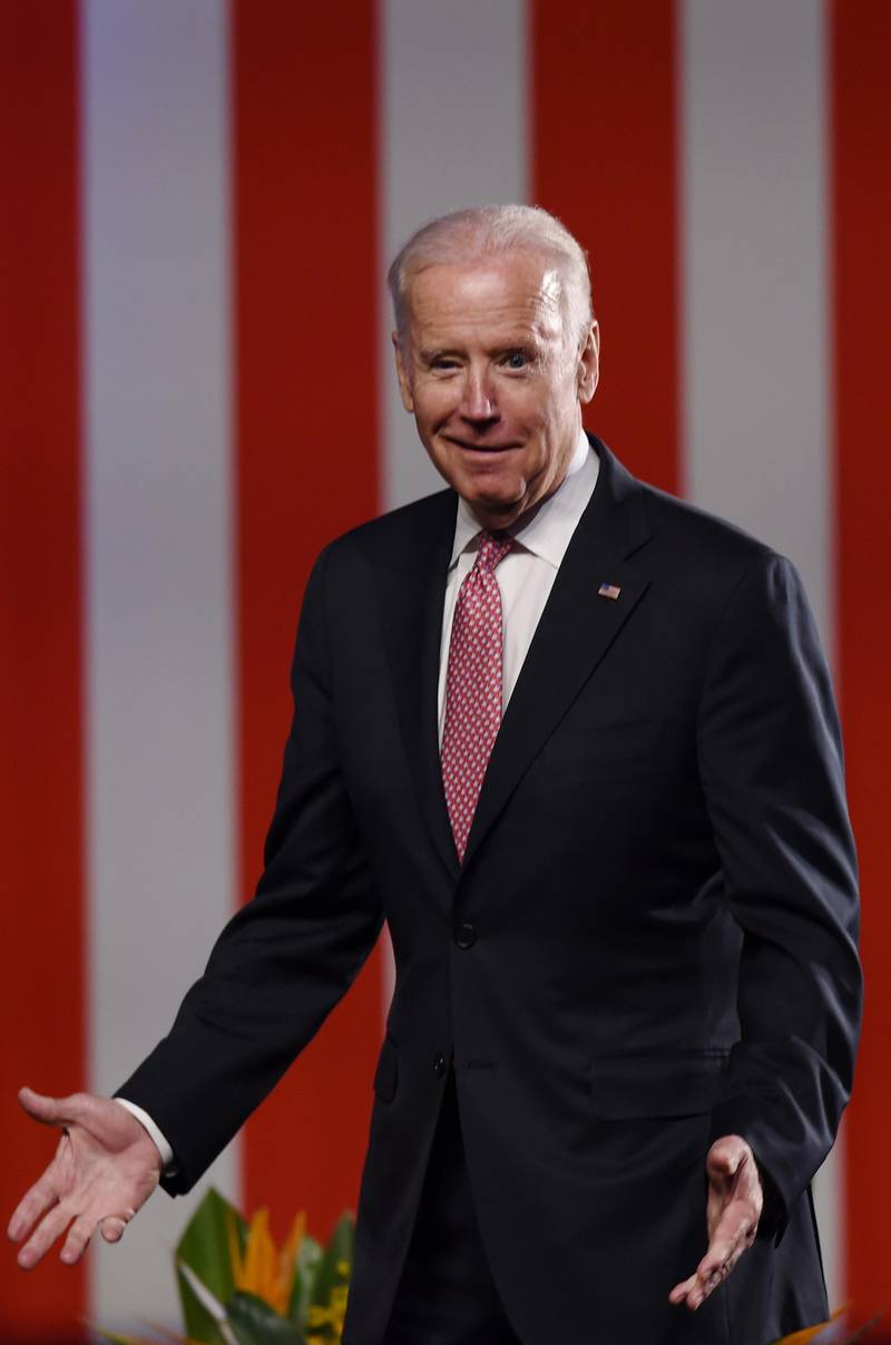 epa05432819 US Vice President Joe Biden reacts to tripping on a step before delivering his policy address on the future of the US-Australia relationship, in Sydney, New South Wales, Australia, 20 July 2016. Biden is on a four-day visit to Australia as part of a tour of the Pacific.  EPA/PAUL MILLER AUSTRALIA AND NEW ZEALAND OUT