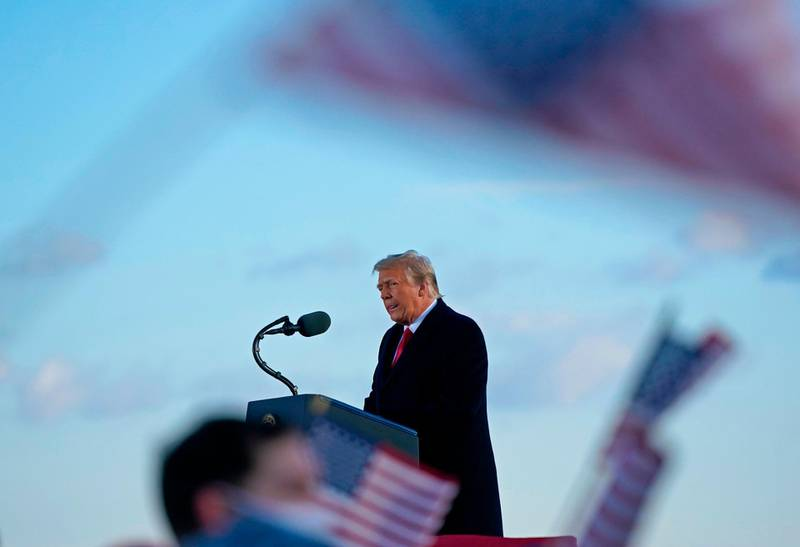 (FILES) In this file photo taken on January 20, 2021, utgoing US President Donald Trump addresses guests at Joint Base Andrews in Maryland.  Donald Trump will face an impeachment trial in the Senate over the ransacking of the US Capitol after the impeachment article against the former president is sent to the chamber on January 25, 2021, its Democratic leader Chuck Schumer announced. / AFP / ALEX EDELMAN