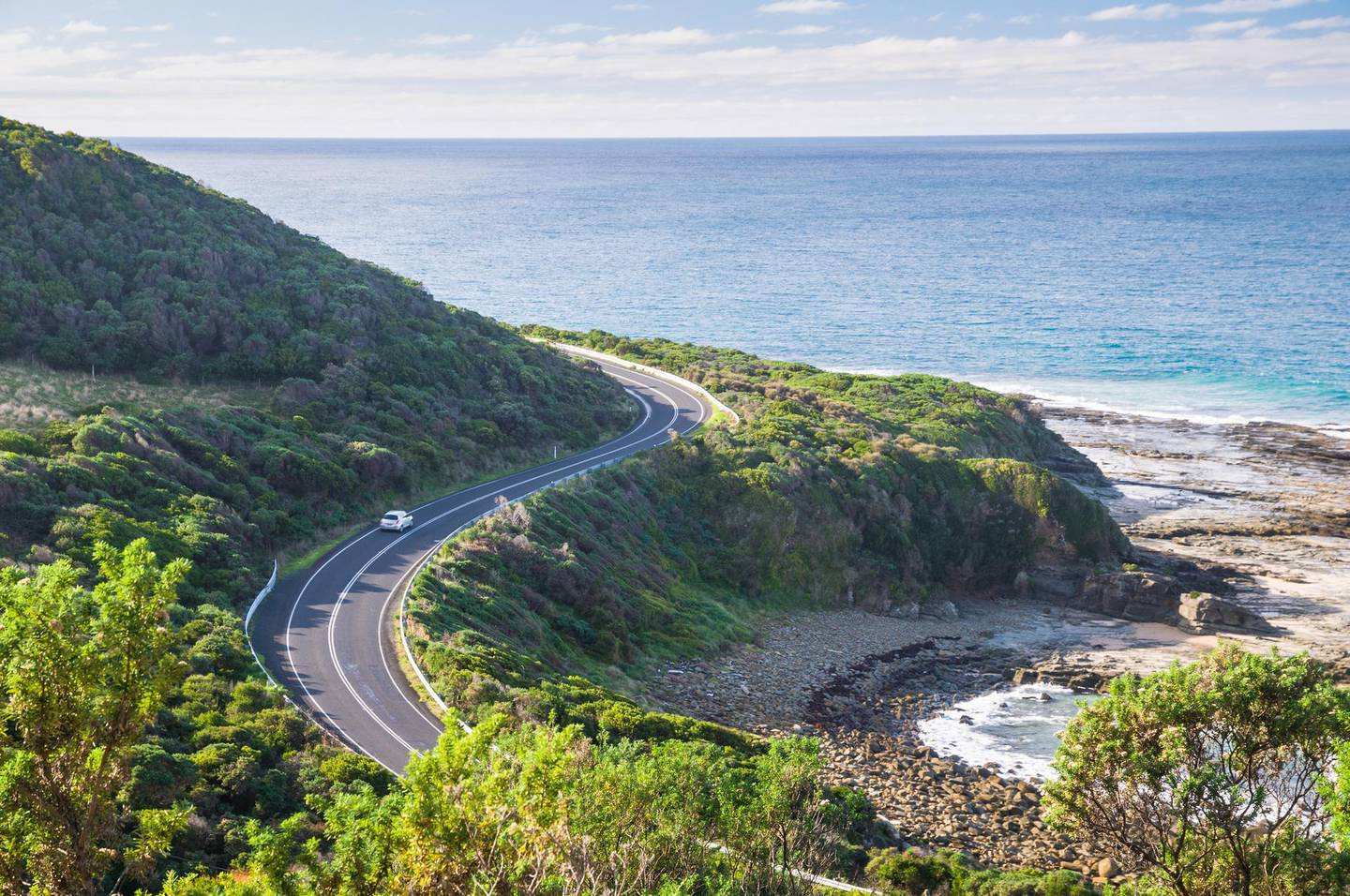 The waters of Bass Strait and a car on the Great Ocean Road, seen here between Kennett River and Skenes Creek, southern Victoria. Getty Images