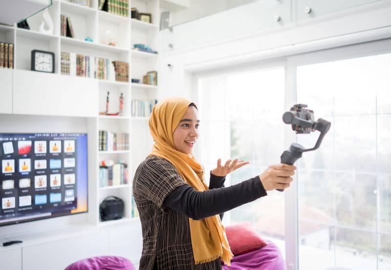 Muslim demonstrating Hijab fashion online