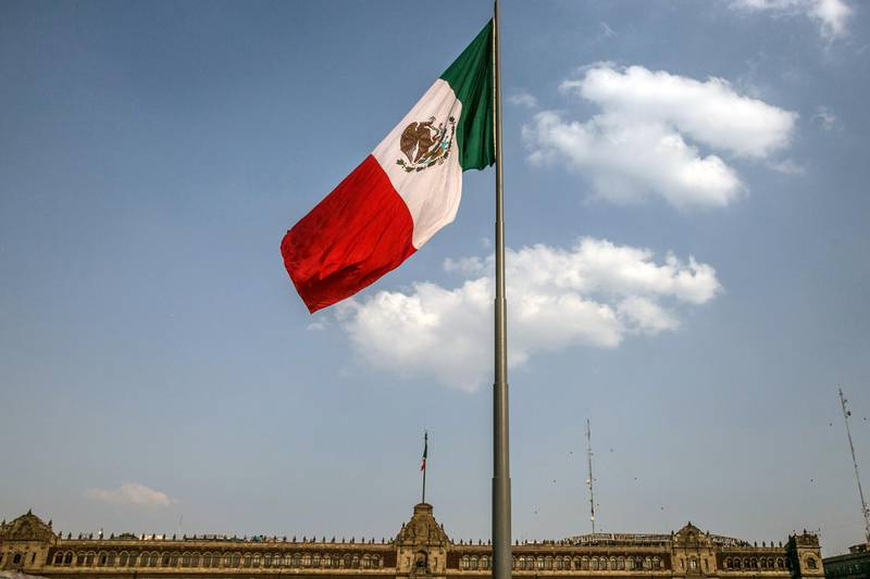 A Mexican flag flies outside the National Palace building in Mexico City, Mexico, on Friday, Feb. 16, 2018. The National Institute of Statistics and Geography (INEGI) is scheduled to release gross domestic product (GDP) figures on February 23. Photographer: Alejandro Cegarra/Bloomberg