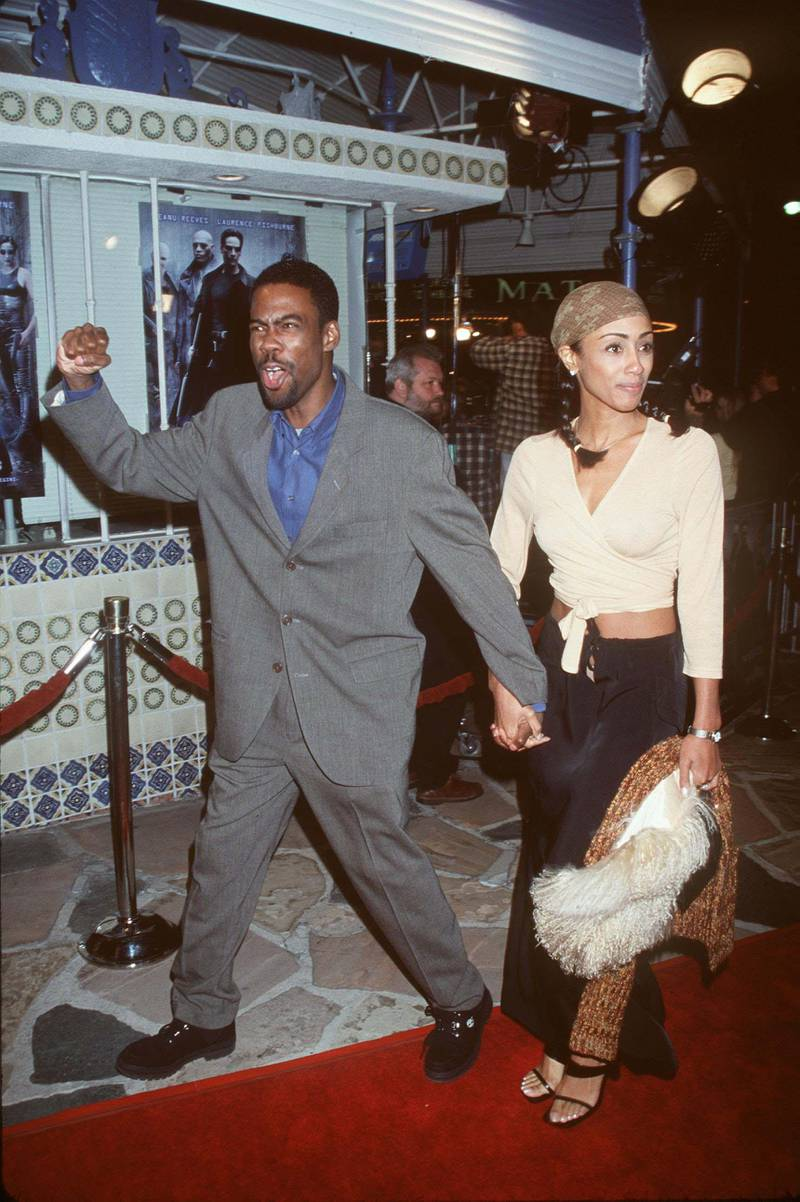 """03/24/99. Westwood, CA. Chris Rock arrives at the world premiere showing of the new film """"The Matrix"""" with date at the Mann's Village Theatre. Photo Brenda Chase/Online USA, Inc./Getty Images"""