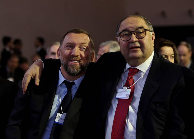 FILE: Oleg Deripaska, chief executive officer of United Co. Rusal, left, smiles with Russian billionaire Alisher Usmanov, before the opening keynote speech on the first day of the World Economic Forum (WEF) in Davos, Switzerland, on Wednesday, Jan. 23, 2013. United Co. Rusal -- the biggest aluminum maker outside China -- and seven other Deripaska-linked firms were the most prominent targets in a list of 12 Russian companies the U.S. hit with sanctions on Friday intended to punish the country for actions in Crimea, Ukraine and Syria, and attempting to subvert Western democracies. Our editors select the best archive images on Deripaska and Rusal. Photographer: Chris Ratcliffe/Bloomberg