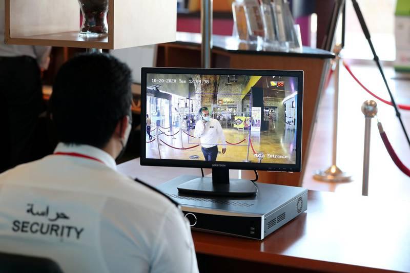 Dubai, United Arab Emirates - Reporter: N/A. News. Coronavirus/Covid-19. A security guard monitors visitors temperatures at Times Square in Dubai. Tuesday, October 20th, 2020. Dubai. Chris Whiteoak / The National