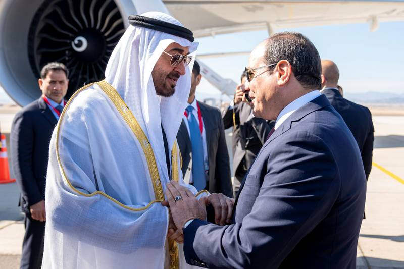 BERENICE, EGYPT - January 15, 2020: HH Sheikh Mohamed bin Zayed Al Nahyan, Crown Prince of Abu Dhabi and Deputy Supreme Commander of the UAE Armed Forces (L) is received by HE Abdel Fattah El Sisi, President of Egypt (R), upon arrival at BereniceMilitary Base.  ( Hamad Al Kaabi /  Ministry of Presidential Affairs ) —