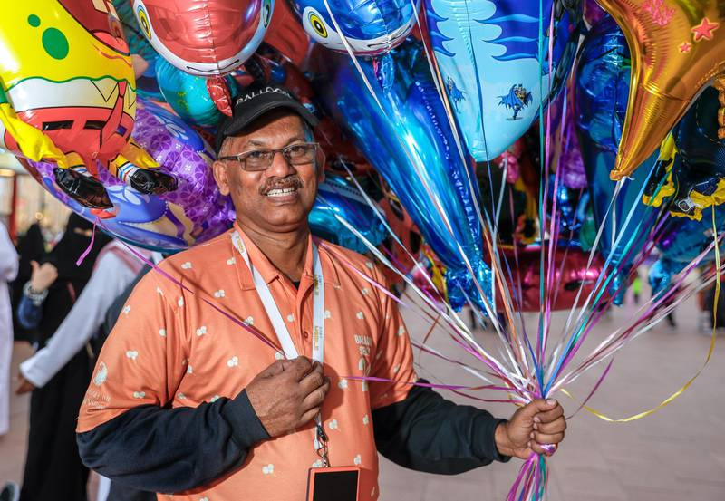 Abu Dhabi, United Arab Emirates, January 5, 2020.  Photo essay of Global Village.--  Mr. Ali, has been selling balloons at the Global Village for 10 years now.  He is from India.Victor Besa / The NationalSection:  WKReporter:  Katy Gillett