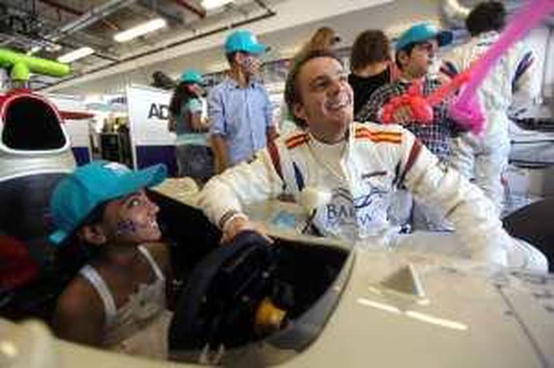 February  3, 2010/ Abu Dhabi /  GP2 race car driver Giedo Van Der Garde shows Noor Rashid around a GP2 race car at the Yas Marina Circuit February 3, 2010. (Sammy Dallal / The National)       *** Local Caption ***  sd-020310-GP2-04.jpg