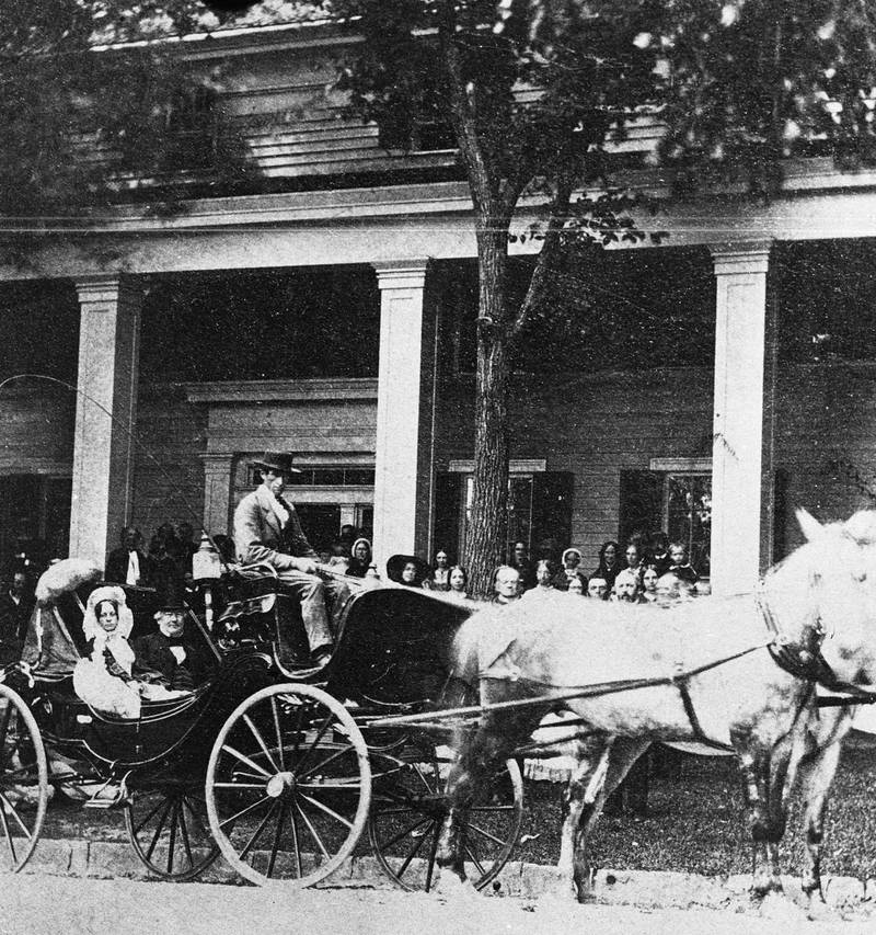 US president Millard Fillmore (1800 - 1874) and First Lady Abigail Fillmore sit in the back of a horsedrawn carriage while vacationing in Saratoga Springs, New York, circa 1851. (Photo by Hulton Archive/Getty Images)