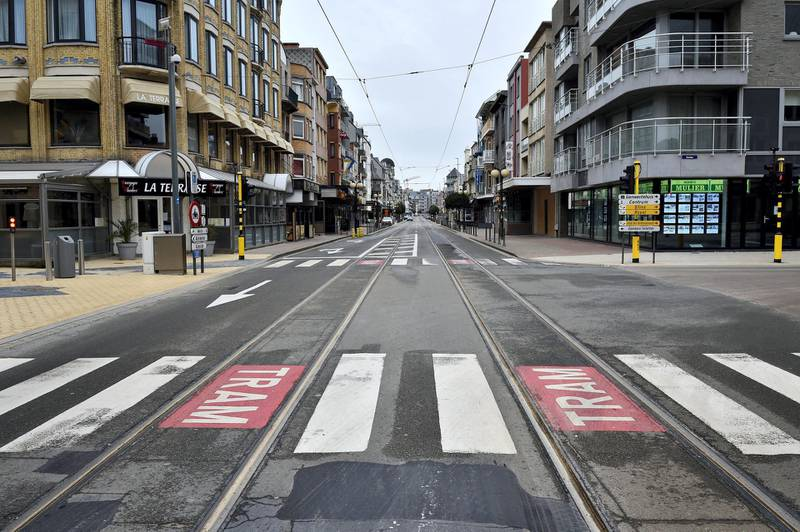 This picture taken on March 20, 2020 shows the deserted streets of Belgium's West Flanders city of Koksijde as a lockdown is in effect in the country to prevent the spread of the COVID-19 caused by the novel coronavirus. (Photo by JOHN THYS / AFP)