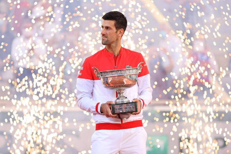 PARIS, FRANCE - JUNE 13: Novak Djokovic of Serbia celebrates as he holds the trophy after winning his Men's Singles Final match against Stefanos Tsitsipas of Greece during Day Fifteen of the 2021 French Open at Roland Garros on June 13, 2021 in Paris, France. (Photo by Clive Brunskill/Getty Images)