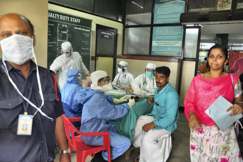 Medics wearing protective gear examine a patient at a hospital in Kozhikode in the southern state of Kerala, India May 21, 2018. Picture taken May 21, 2018. REUTERS/Stringer