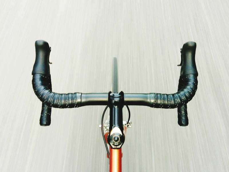 Cropped Image Of Bicycle On Road. Getty Images