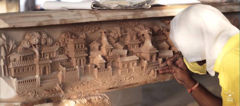 A screenshot showing craftsmen in India working on the columns and pillars of the Hindu temple in Abu Dhabi. Courtesy: BAPS Hindu Mandir
